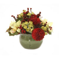 green orchids with red mums